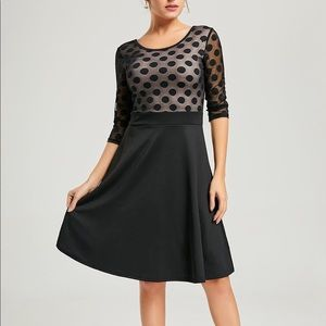 Black dress with skin tone on top